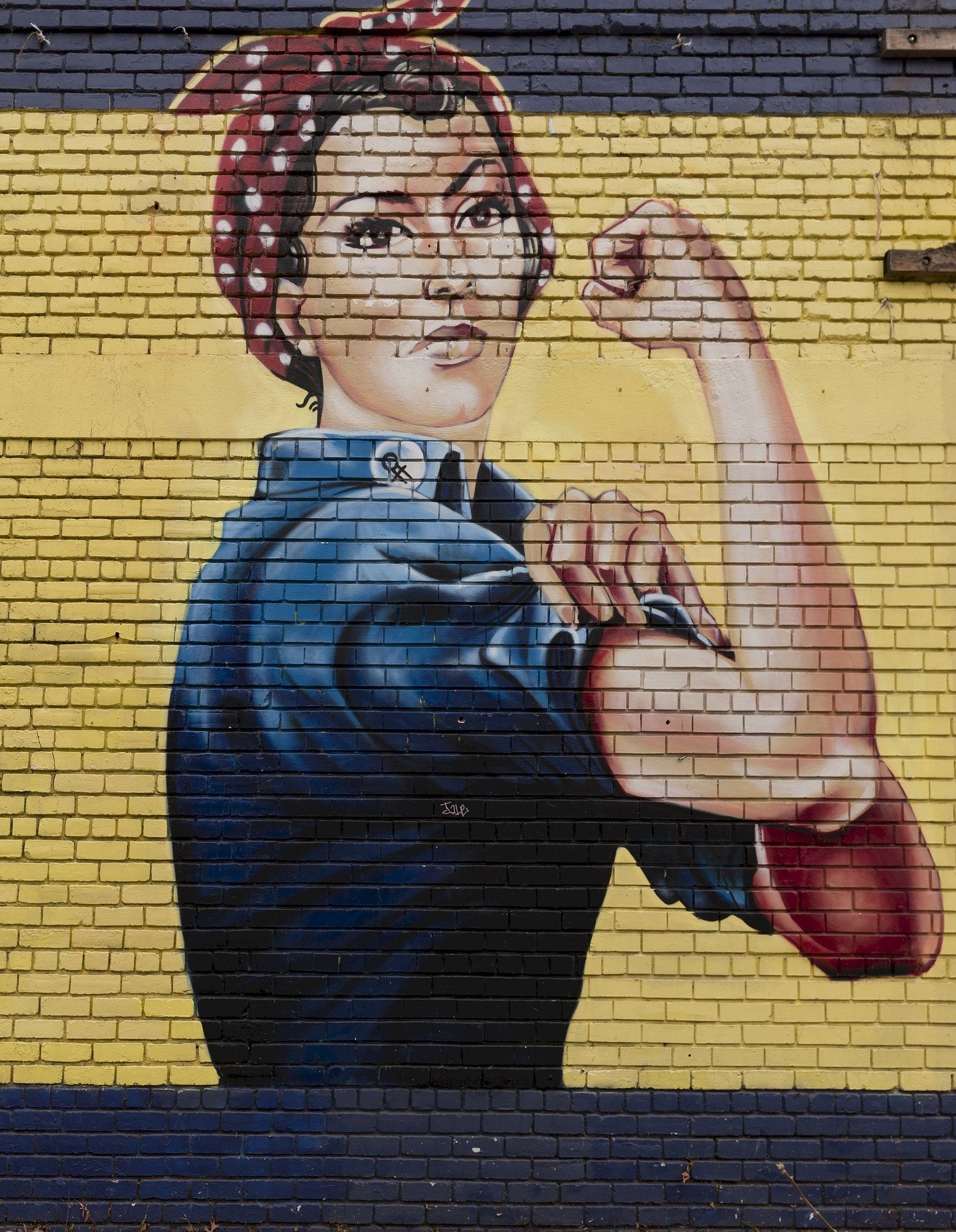 Rosie the Riveter as painted on a brick wall